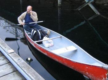 Gerry Thomasen, Nanaimo Realtor on his phone in a canoe